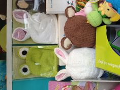 Knitted baby hats with rabbit or bear ears.