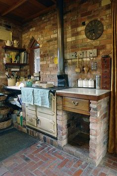 Open shelves, rustic brick walls and floor with somewhat of a Gothic window.