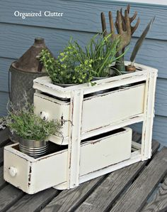 Sewing Machine Drawers Re-purposed As Plant Holder via OrganizedClutter.net