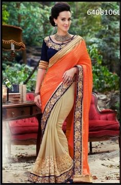Brijraj sarees available at great discounts. A beautiful orange and beige party wear saree with a blue blouse and intricate embroidery.