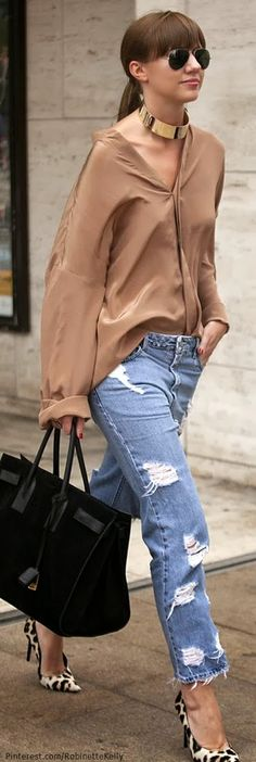 Love the half tucked in shirt with the tattered jeans. This look gets a touch of glam with the animal print heels.