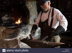 Stock image of a blacksmith forging iron nails in the Acadian Village near Caraquet New Brunswick Canada Stock Photo