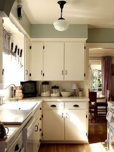 Find more ideas: DIY Small Kitchen Remodel On A Budget Dark Small Kitchen Remode. Find more ideas: DIY Small Kitchen Remodel On A Budget Dark Small Kitchen Remodel Before And After Cream Colored Kitchen Cabinets, Cream Colored Kitchens, Kitchen Cabinet Colors, Kitchen Colors, White Cabinets, Old Kitchen Cabinets, Green Cabinets, Kitchen Shelves, Small Kitchens