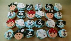 Pirates, maps, anchors and skull flags cupcakes for Charlie's 1st! Chocolate cake with chocolate filling and vanilla cake with vanilla filling.