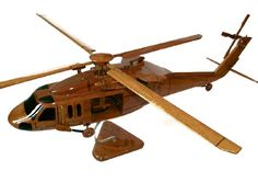 "A beautiful hand carved desktop model of the UH-60 Blackhawk. The model has been carved from solid mahogany. The model comes boxed and is simple to assemble. The rota's, tail fins and stand simply slot into pre-drilled holes on the body of the aircraft. No glue required. Size H 9"", L 22"", Rota 21"". Visit our website at thewoodenmodelcompany.co.uk to view the full range of our models."