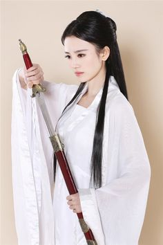 Ju Jingyi, a member of pop idol group as Little Dragon Maiden, the fictional female protagonist of the wuxia novel The Return of the Condor Heroes by Jin Yong (Louis Cha) Tattoo Guerreiro, Asian Woman, Asian Girl, Sword Poses, Katana Girl, Female Samurai, Martial Artists, Dress Clothes For Women, Warrior Girl