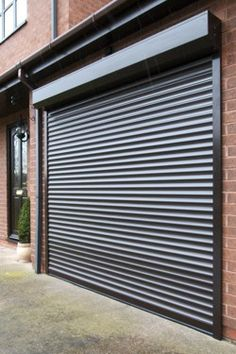 Thermaglide roller door fitted externally over ART STUDIO glass windows.