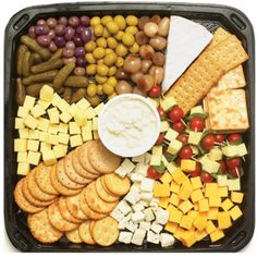 Checkers & Checkers Hyper Christmas Platter - 6 cheeses (white cheddar, gouda, creamy blue cheese cubes, cream cheese, brie & mozzarella) with cherry tomato sticks, olives, pickled onions & gherkins, accompanied by crackers (R250)