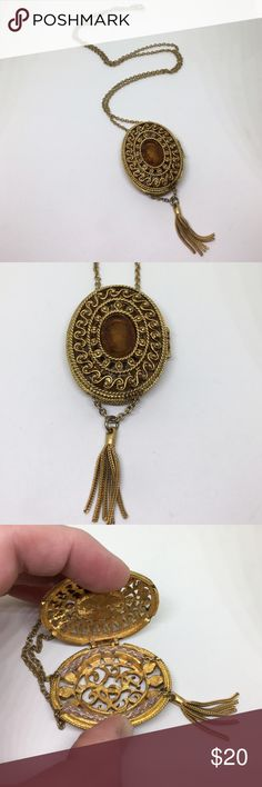 """Vintage Intaglio Cameo Locket Necklace A 3"""" Antique Gold finish Locket with a brown faceted intaglio cameo, strung on a 26"""" antique gold chain. The locket has a spring hinge, and is meant to be used as a scent locket. The back of the locket is open, and would allow any scented oil drops on a cotton ball to drift slowly out all day long. A sturdy piece, in very good vintage condition. Only a very small loss of plating is noted. An overall amazing piece! Vintage Jewelry Necklaces"""