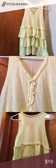 Yellow ruffled tank top Pretty light yellow. Has small buttons all the way down the front. The ruffles make this super cute. Mystree Tops Tank Tops