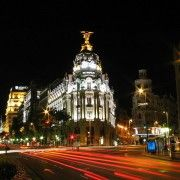 Madrid by night. The Metropolis building marks the start of Gran Vía in Madrid city centre, a short walk from AIL Madrid Spanish school. Oh The Places You'll Go, Places To Travel, Places To Visit, Barcelona, Alicante, Budapest, Madrid Guide, Visit Madrid, Madrid City