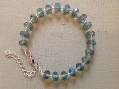 Crystal bracelet in gorgeous pale green with clear seed beads. This bracelet reflects the light beautifully shimmering green, blue and aqua.