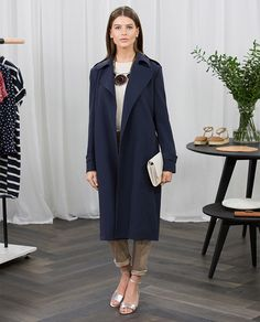 How to Wear | The Draped Navy Trench. Styling Tip:  Add the shoe of the season – a silver block-heel sandal – and clutch to dress up this minimal trench