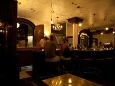 "This charming throwback Queens joint is perfect for a ""just drinks"" date that you hope turns into something more. Start in the dark wood-paneled bar where bow-tied bartenders serve up classic cocktails with a twist, like the Mar's Manhattan made with black mission fig bitters. Then, head to the candlelit bistro tables, order oysters from the raw bar, and listen to the 1930s tunes playing from retro speakers."