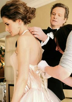 Colin Firth helping his wife Livia with her dress.