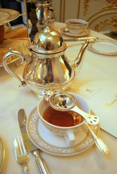 Afternoon tea, served properly of course, at the Ritz.