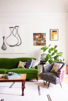 Eclectic living space with a green couch and patterned chair