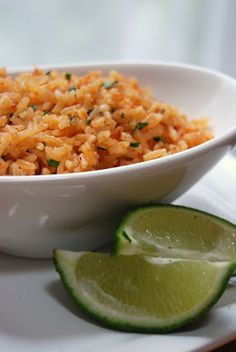 Mexican Rice-I just made this to go with fajitas. It's petty tasty. I did not puree the onions, i just added them when i added  them with the garlic. ALSO i did not have any tomato paste so i used about a 1/3c of tomato sauce. (carol)