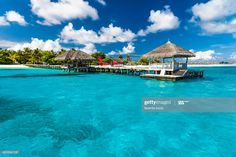 Stock Photo : Perfect tropical island paradise beach Maldives. Long jetty and a traditional boat dhoni.