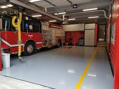 A fire station floor completed with Solids Primer & Polyester Polyurethane Light Gray & Caution Yellow. is designed to withstand the heavy traffic from fire trucks, has excellent stain resistance, and provides long term gloss & color stability. Concrete Floor Coatings, Concrete Floors, Fire Trucks, Stability, Flooring, Gray, Yellow, Color, Design