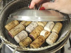 Easy prep to cut up corks for craft projects:  Place corks in a mesh basket or wire sieve, then put that in a shallow pan.  Weight the corks down with a small pot lid.  Add enough boiling water to cover the corks & let them soak for 10 minutes. They can then be cut without crumbling.  #DIY #craft #repurpose #reuse #recycle