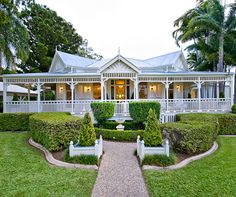 This front garden with a water feature leading to double stairs. Restoring the Old Girl: A Study in the Classics A stunning Queenslander in Rockhampton