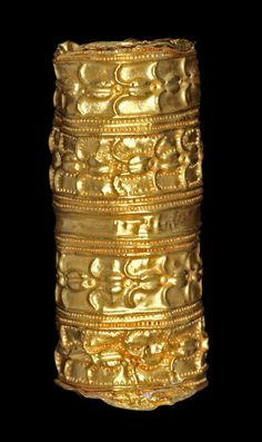 Africa | Hollow lost wax casting in gold of a cylindrical bead (sika brodua) with repoussé decoration. | Asante people, Ghana | 19th century || {3.23}