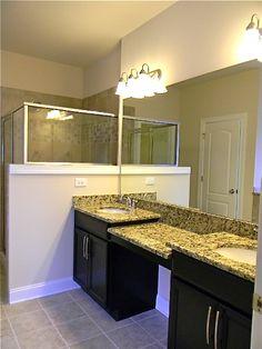 Owner's Bathroom.  Timberlake Tahoe Maple Espresso Cabinets.  Santa Cecilia Granite.