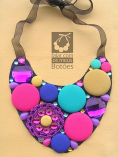 "Fabric covered buttons necklace with crochet made by ""Falar com os meus botões"". Visit us on Facebook!"