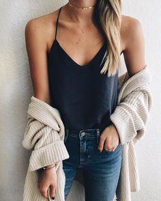Sexy yet cozy style - oversized knit cardi and black cami with jeans