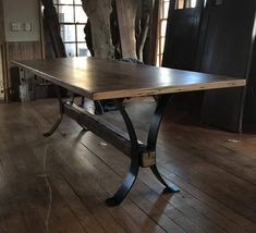 Wormy chestnut top rests on a metal base with hewn trestle. Farm Dining Table, Farmhouse Kitchen Tables, Dinning Room Tables, Rustic Table, Wooden Tables, Whiskey Barrel Furniture, Kitchen Banquette, Kitchen Nook, Hardwood Table