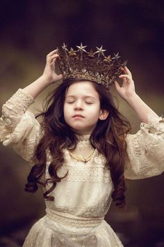 "Lilla breathed in and closed her eyes. She placed the crown on her head. She opened her eyes and looked at herself from all angles with the crown, but no matter how hard she tried, it didn't look right. ""Maybe I'm not really a princess."" she thought."