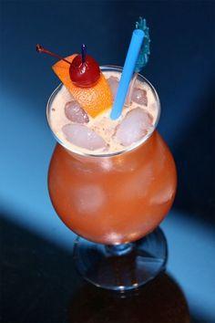 The Monkey Passion Cocktail in huge hurricane glass (Тропический коктейль Страсть Обезьяны в огромном бокале)