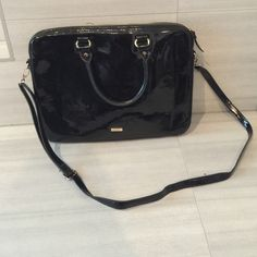 """Shiny Black Aldo Laptop Bag Aldo laptop bag - black, shine finish. Some scratches from daily uses that are visible when closely inspected. Zipper pull has a bit of discoloration and tarnishing on metal part and the the stitching has come loose inside (please see pic). Measurements width 14 3/4"""" height 10 3/4"""" depth 1"""". Will fit laptops 14"""" or less. ALDO Accessories"""