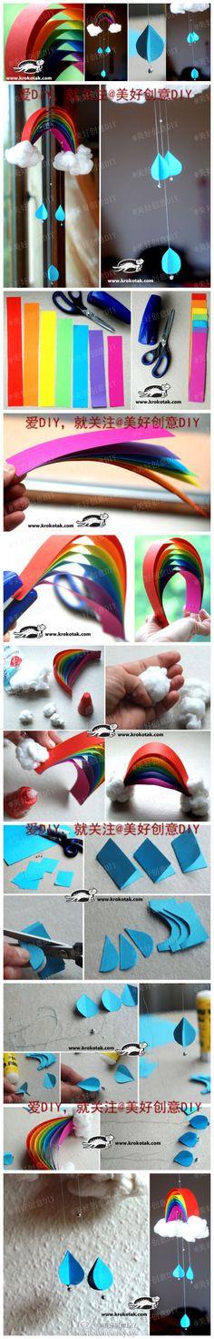 Mobile arco iris feito papel colorido e algodao e fio de nylon :) Ja fiz ficou tao bomito (: