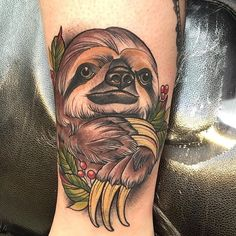 It's a sloth! really cool tattoo made by @matt_edwards_tattoos   Greoffrey the sloth! #support_good_tattooing #support_good_tattooing_uk #slothtattoo #tradsloth #tattoos #tattooartist #whip #lacenanotattoomachines
