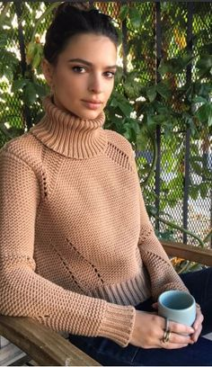Who made Emily Ratajkowski's blue jeans and tan sweater?