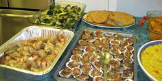 top left to right: baked broccoli with red pepper flakes and garlic, baked flounder, dried cod in tomato sauce, baked shrimp, baked clams, risotto with saffron, etc.