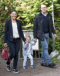 Crown Princess Victoria in blazer and jeans with her daughter, Estelle, and her husband Prince Daniel.