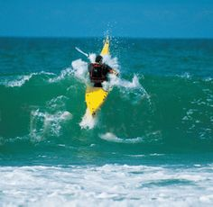 Entering the surf on a kayak takes skill and timing of the wave sets.