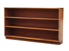 Handmade studio bookshelf in solid American black walnut. Nice joinery at the base and top. Good use of deeper heartwood and sap. This is the kind of simple, clean-lined piece that can go so many different ways depending on accessories. It is sturdy, well-made, and so usable in many areas.  USA, 1970s.   CONDITION NOTES: Very good original condition, age appropriate wear- nicks, marks, imperfections.