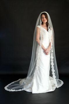 A traditional and very romantic chapel length alencon lace mantilla {Jaclyn Jordan New York}