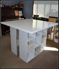 totally wanna do this w/ a longer table top, and a shorter storage maybe 2 high...make a kitchen table!!!