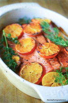 Salmon cooked with clementines is a vibrant way to enjoy the health benefits of salmon