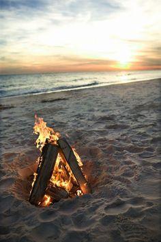 Beach bonfires at sunset.