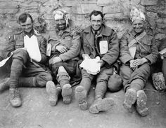 A portrait of four smiling Canadians, as they sit against a wall and await treatment at a Casualty Clearing Station (CCS) at Duisans, 3 September 1918 Ww1 History, World History, Military History, World War One, First World, Canadian Army, Canadian Soldiers, Flanders Field, Funny Hats