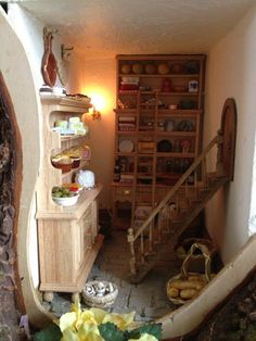This is the pantry in a dollhouse! amazing! Miniature Mouse Tree Dolls House inspired by Brambly Hedge.