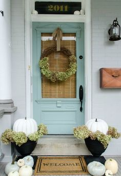 Light blue paint adds a sweet touch to this front porch.