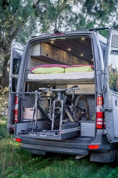garage has more than enough storage for all your toys. Ford Transit Conversion, Van Conversion Interior, Sprinter Van Conversion, Camper Van Conversion Diy, Van Conversion With Garage, Iveco Daily Camper, Iveco Daily 4x4, Mercedes Sprinter Camper, Bike Storage In Van