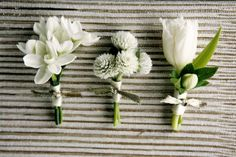 all white boutonnieres